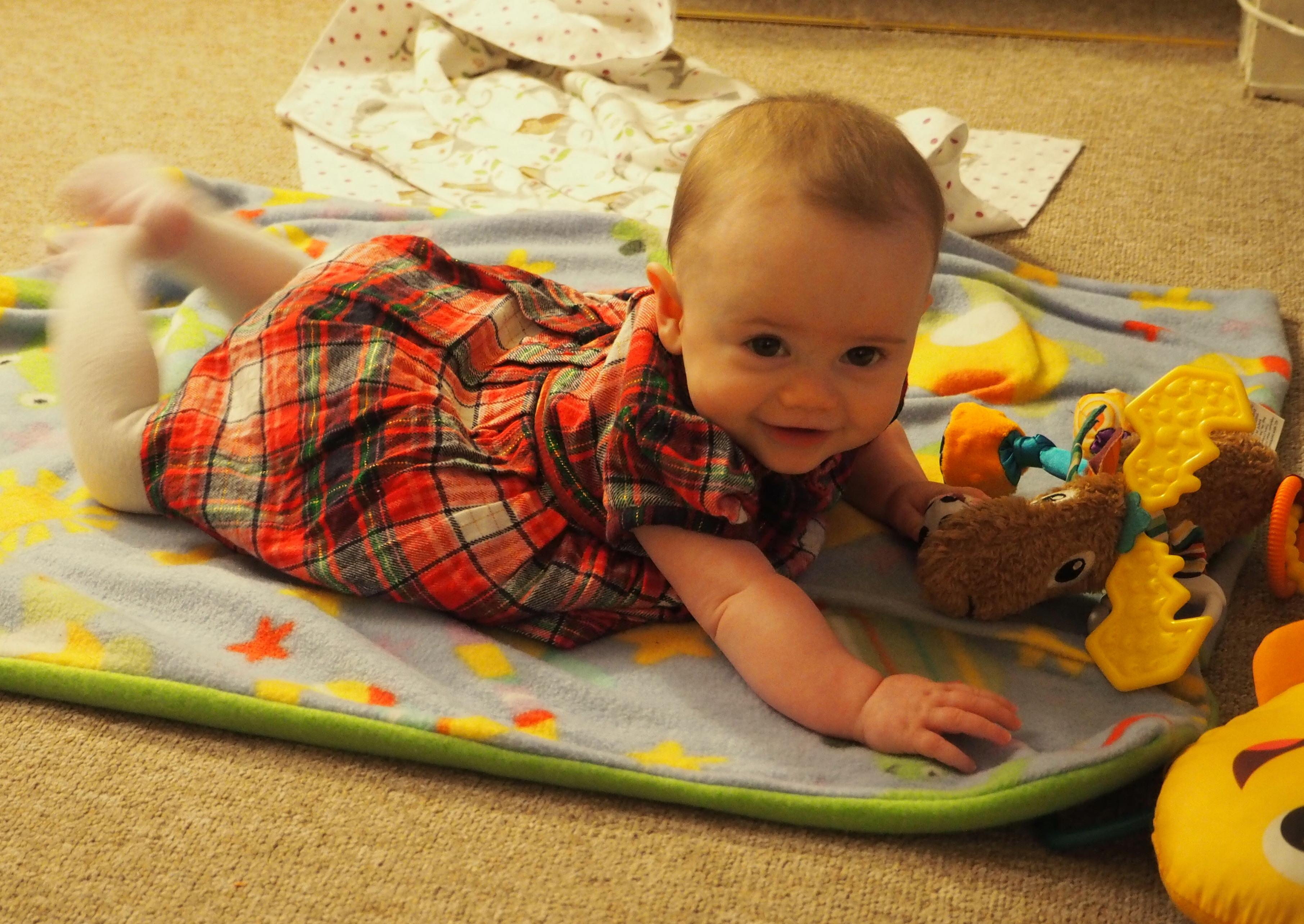 Cute baby in a tartan dress
