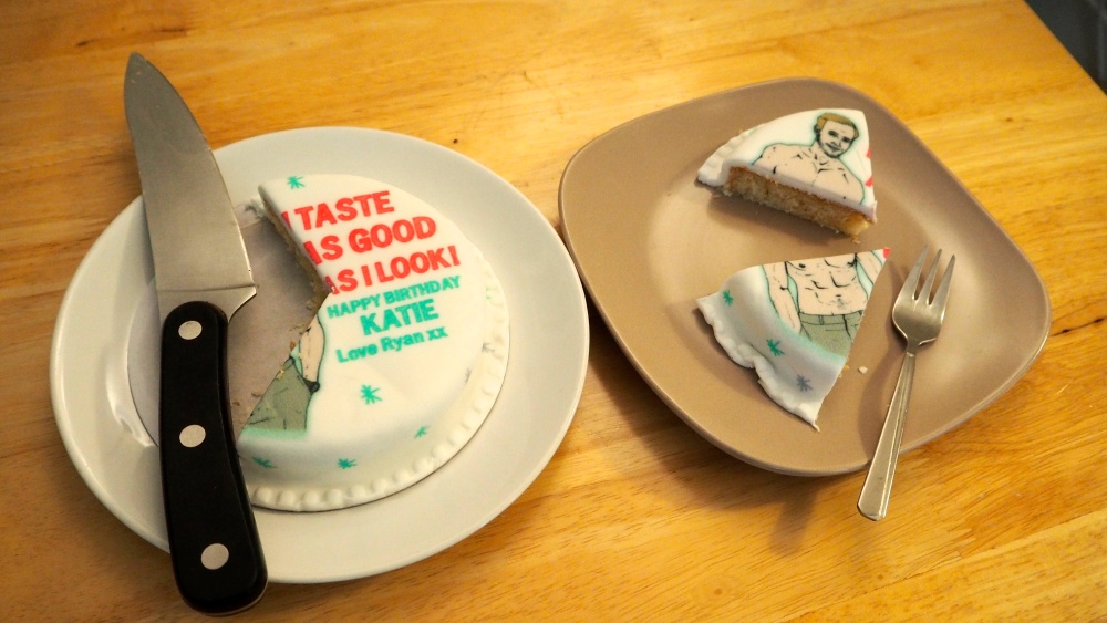 Ryan Gosling Baker Days cake with two slices cut out