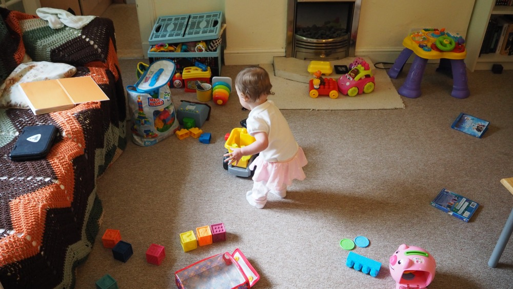 The Popple playing in a messy living room